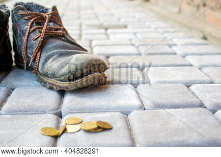 Old Worn Leather Boot In Dark Blue With Colorful Brown Laces. Poverty Concept. Old And Torn Shoes An