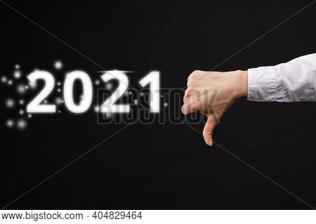 Bad Assessment Concept For 2021. Hand Shows Thumbs Down