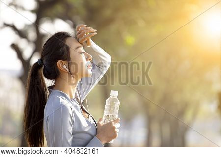 Young Woman Drinking Water After Jogging Background