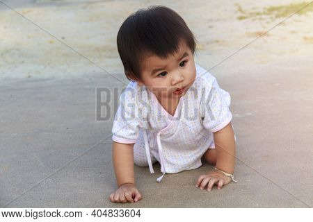 Small Baby, Little Girl Creeping, Playing On Road And Sant At Beach. Cute Baby Try To Creeping And P