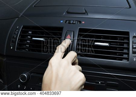 Close Up Hand Press The Emergency Light In The Car, Fingers Press Button.for Open The Contract Emerg