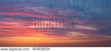 Colourful Background of a Beautiful Tranquil Sunset Sky. Peaceful View on a Clouds in the Evening Skyscape.