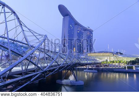 Singapore - Mar 20 : Nightscape Of Singapore Marina Bay Sand And Helix Bridge On March 20,2015 In Si