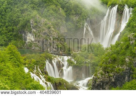 Long Exposure Shot Of Veliki Slap, The Largest Waterfall At Plitvice, At On A Rainy Misty Day At Pli