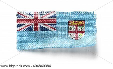 Fiji Flag On A Piece Of Cloth On A White Background