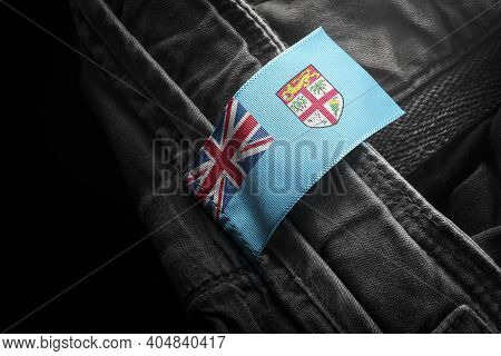 Tag On Dark Clothing In The Form Of The Flag Of The Fiji