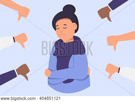 Cheerful Young Woman Is Surrounded By Hands With Thumbs Down. The Concept Of Public Disapproval, Non