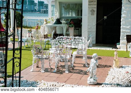 Busan,south Korea-october 2020: European Style House With White Bench, Table And Statue At The Front