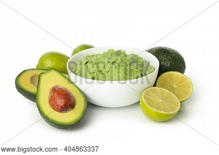 Bowl Of Guacamole, Avocado And Lime Isolated On White Background