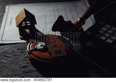 House Keys With Wooden Gavel On A Table