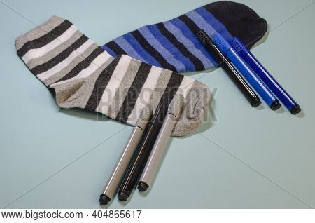 Concept Of Harmonized Colors And Shades. Minimalist Composition With Socks And Felt-tip Pens Of The