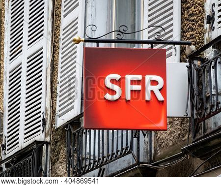 BAYONNE, FRANCE - CIRCA DECEMBER 2020: SFR shop sign in the town center. SFR is a French telecom company.