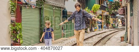 Banner, Long Format Father And Son Travelers Walk Around Railway Paths Which Go Through Residential