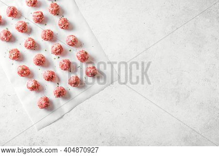 Raw Meatballs On White Background, Top View, Copy Space. Beef Meatballs Ready For Cook.