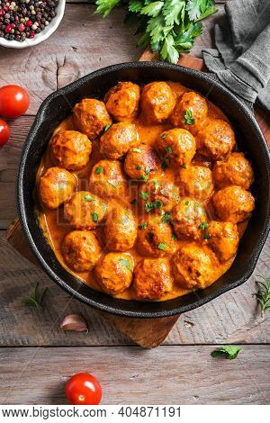 Homemade Meatballs In Tomato Sauce. Beef Meatballs In Cast Iron Pan On Wooden Background.