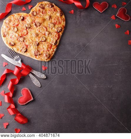 Valentine's Day. Romantic Dinner. Top View. Heart Shaped Pizza, Cutlery, Red Ribbon And Hearts On A