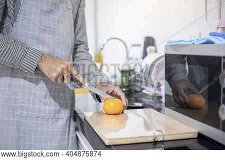 Blurred Man Asian Cooking In Kitchen Of Home He Hands Cutting Vegetables And Cutting Fruit In The Ki