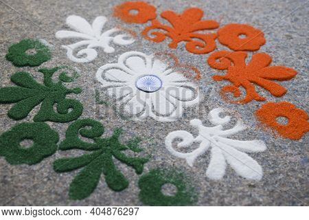 Tri Color Rangoli Of Flower Motif Design Drawn And Coloured On The Occasion Of Indian Republic Day W
