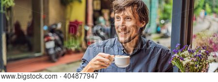 Banner, Long Format Young Man Traveler Drinks Vietnamese Coffee With Egg Sitting By The Railway Path