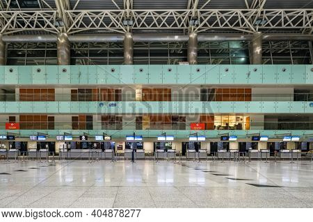 Izmir, Turkey - December 6, 2020: Empty check-in area in Izmir Adnan Menderes Airport during Covid-19 coronavirus pandemic. Only few flights per day left during pandemic times