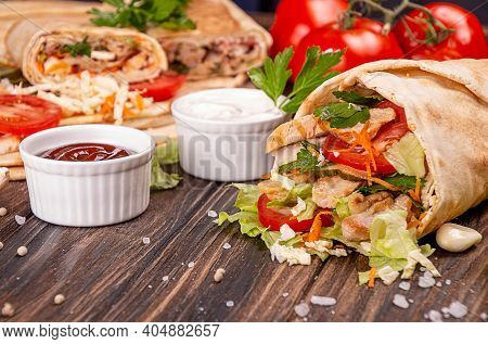 Popular Arabic Turkish Fastfood Doner Shawarma Roll With Meat And Vegetables And Ingredients On Wood