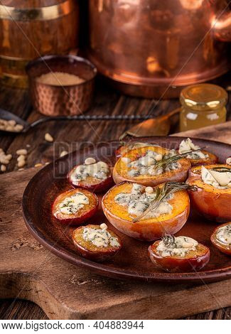 Grilled Baked Peach And Plums Stuffed With Blue Cheese Dorblu And Rosemary.