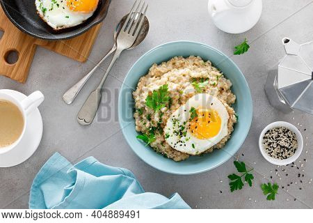 Savoury Oatmeal With Fried Eggs Sunny Side Up For Breakfast