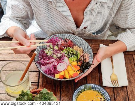 Woman Eating Tasty Colorful Healthy Natural Organic Vegetarian Hawaiian Poke Bowl Using Asian Chopst