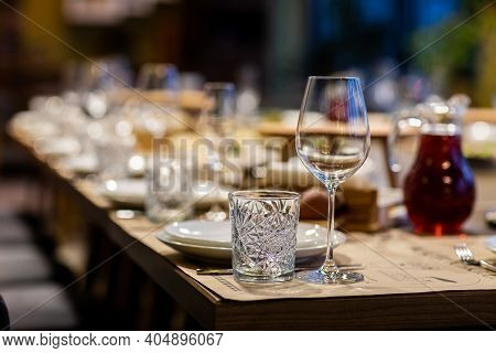 Tables Set For An Event Party Or Wedding Reception. Luxury Elegant Table Setting Dinner In A Restaur