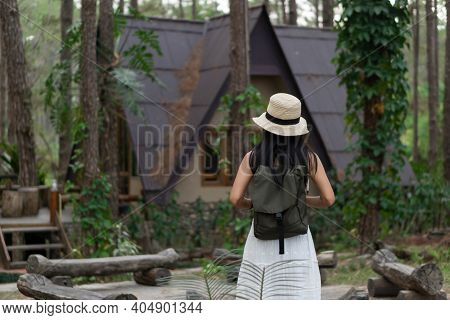 Asian Female Tourist In White Dress With Vacation In A Pine Forest At Doi Bo Luang, Chiang Mai, Thai