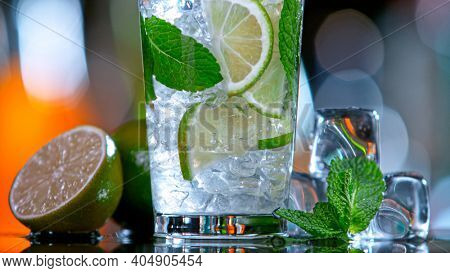 Fresh mojito cocktail in a bar slashing, close-up.