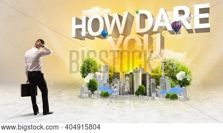 Rear view of a businessman standing in front of HOW DARE YOU inscription, Environmental protection concept