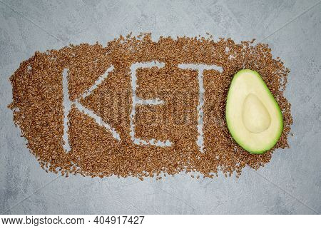 Word And A Half Of Avocado On Gray Background. Balanced Diet. Diet For The Healthy Body. Ketogenic D
