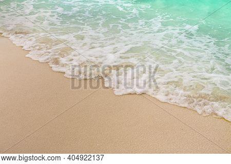Soft Wave And Sea Bubble Of Blue Sea On Sandy Beach