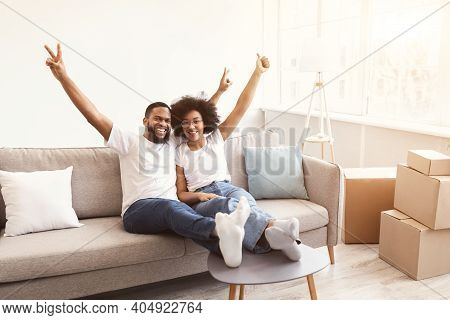 Excited Black Family Couple Celebrating Moving New House After Real Estate Purchase And Relocation S