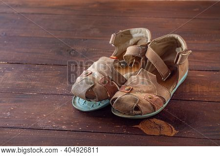Children's Sandals Made Of Leather With A Peeled Sole. Old Worn-out Shoes.