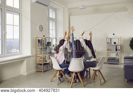 Team Of Women Raising Hands Willing To Take Part In New Project Or Voting For Good Idea