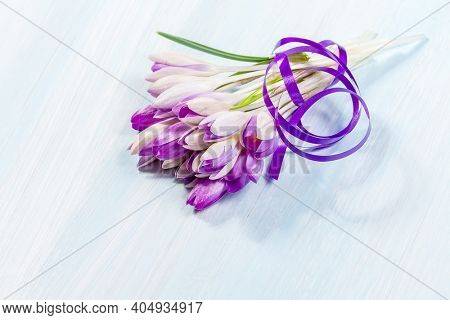 Bouquet of spring crocuses on a wooden table