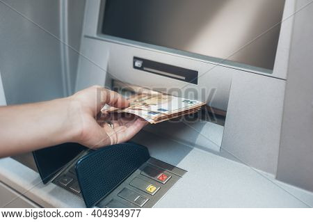 Woman Hand Taking Money From Bank Cash Atm Machine. Close Up. Cash Point. Finance, Transactions, Cre