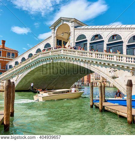 Venice, Italy - June 15, 2018: Traffic in The Grand Canal nearThe Rialto Bridge in Venice