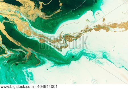 Green And Gold Marble Abstract Acrylic Background. Marbling Artwork Texture. Agate Ripple Pattern. G