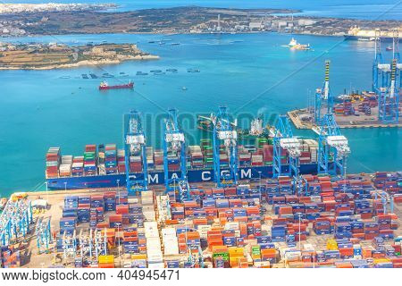 Huge Cma Cargo Ship For Transporting Containers In Port At Unloading. Malta, Il Brolli Marsaxlokk, M