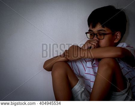 Neglected Lonely Child Leaning At Room Corner With Sadness And Unhappy. Face-palm Concept.