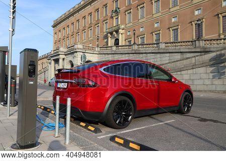 Stockholm, Sweden - August 23, 2018: Tesla Model X Electric Car Charging In Stockholm, Sweden. There