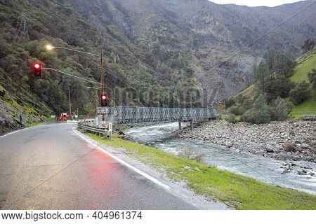 Construction Site At Road With Red Traffic Ligh In Yosemite National Park By Bad Weather With River