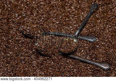 A Bunch Of Flax Seeds In Full Screen. Selected Flax Seeds. Spoon Full Of Flax Seeds.