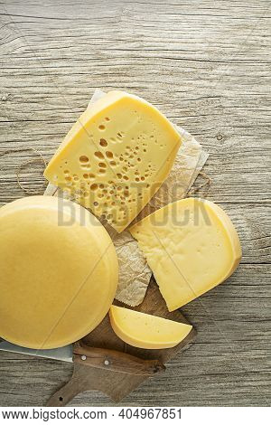 Various Types Of Cheese On Rustic Wooden Table. Top View. Free Space For Text.