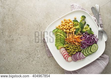 Healthy Vegan Lunch Plate. Vegetarian Salad With Avocado, Chickpeas, Red Cabbage, Green Peas, Red On