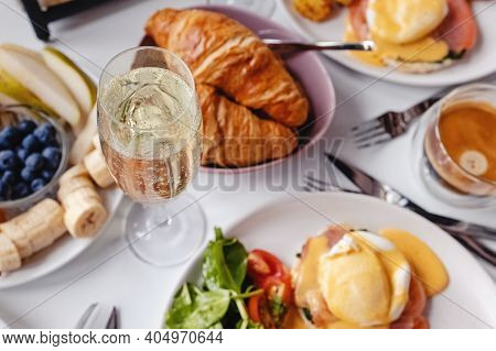 Glass Of Champagne Close-up On The Table With Different Breakfast And Brunch Dishes