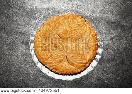 Traditional Galette Des Rois On Grey Table, Top View